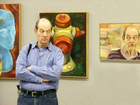 Ben with paintings by Emily White Kebert