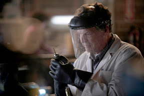FRINGE: Walter (John Noble) preps for evidence collection in the FRINGE episode The No-Brainer