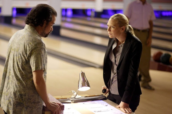 FRINGE: Olivia (Anna Torv, R) visits Sam (guest star Kevin Corrigan, L) at the bowling alley in the FRINGE episode 'Fracture' airing Thursday, Oct. 1 (9:00-10:00 PM ET/PT) on FOX. ©2009 Fox Broadcasting Co. CR: Michael Courtney/FOX