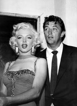 Robert Mitchum y Marilyn Monroe