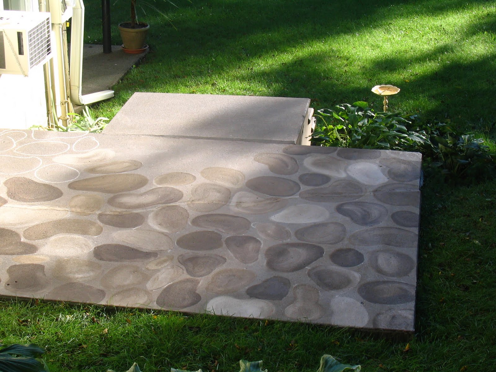 Great Turning And Ugly Concrete Slab Into A Faux Stone Patio