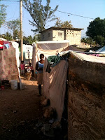 Image of small tent encampments of homeless earthquake survivors who were in desperate need of food and water.