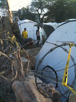 hungry, homeless and sad groups of families living in their ad hoc tent camps all over PAP and just outside the disaster zone