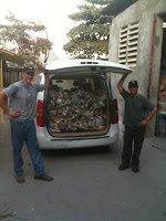 Mark Kirwin and Patrick Rea next to a van full of disaster relief supplies.