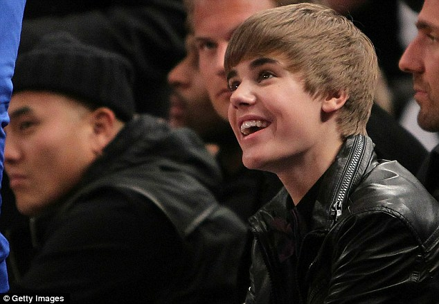 pictures of justin bieber smiling. justin bieber smiling with