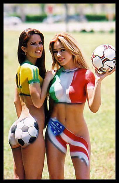 Painting of international flags (Brazil and USA) on semi-nude women soccer ...