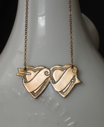 "as you can see in the ""Two Hearts Tattoo Necklace"" from Stella:"