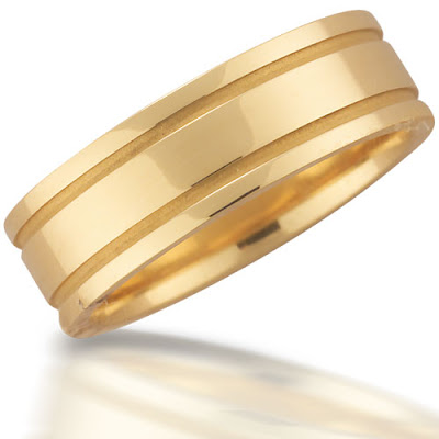 Novell 39s NS10867GCEY is an 18kt gold wedding band that is 7mm wide