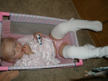 chiilin in dad's socks in dolls crib