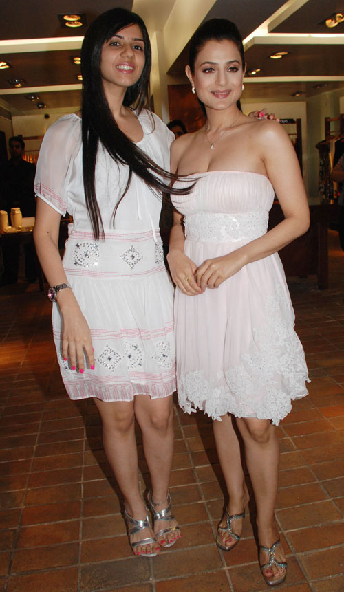 Amisha Patel Smiling with Friends in a White Short Skirt & High Heels