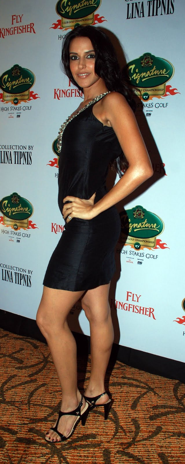 Neha Dhupia in a Short Black Skirt Promoting Signature Club Golf]