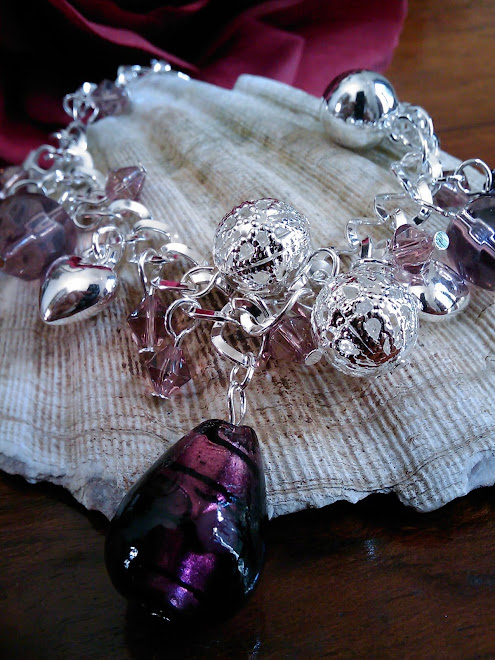 Pretty silver and glass charm bracelet