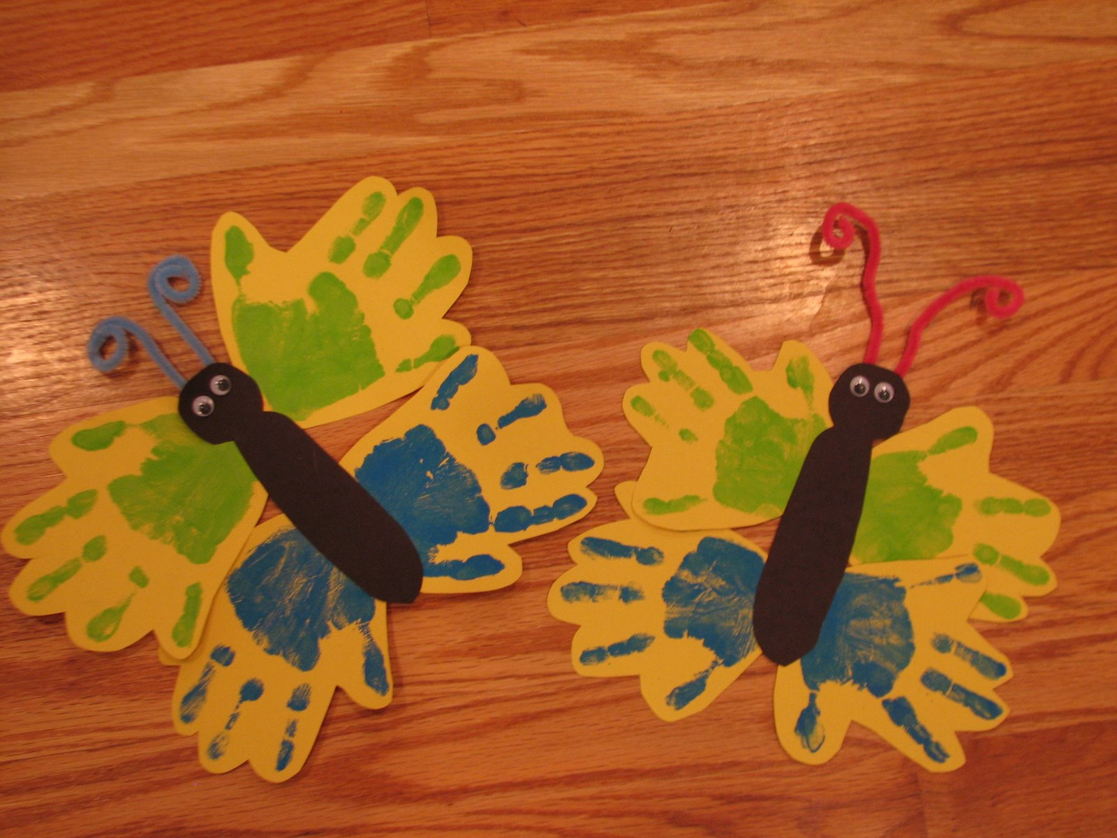 Spring butterfly handprint craft preschool education for for Butterfly hands craft