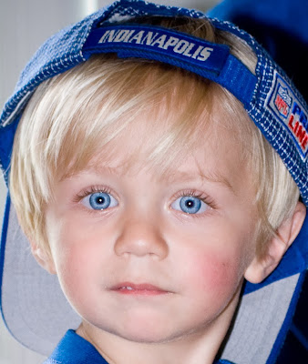 Little Boy With Blue Eyes And Dark Hair