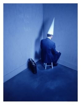 Businessman-Sitting-in-Corner-with-Dunce-Hat-Posters.jpg