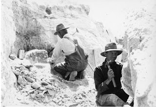 Expedition Members Uncovering Fossils