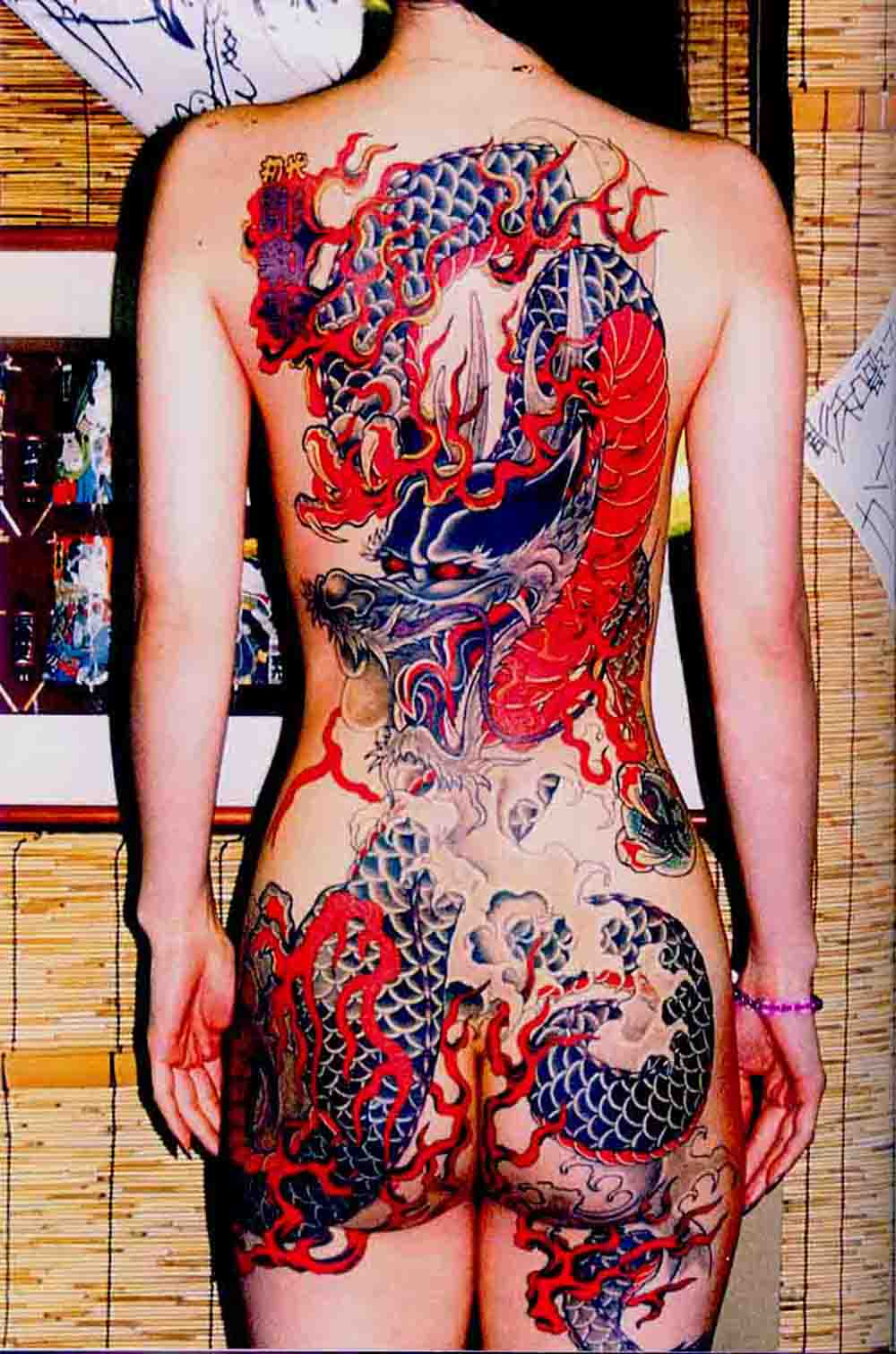 Female Tattoo With Japanese Dragon Tattoo On The Back Body
