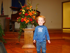 Mac with his birthday flowers at church