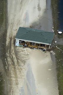 A house lies across Highway 87 near Crystal Beach September 15