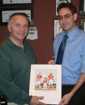 Here I am, presenting my cartoon to Tom Tancredo.