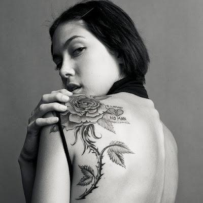 rose tattoos. rose tattoo on elbow.