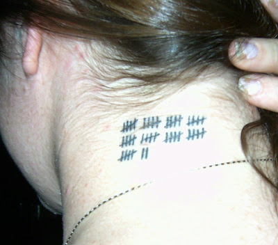 Born on April 7, Megan had these hash marks inked onto the back left side of