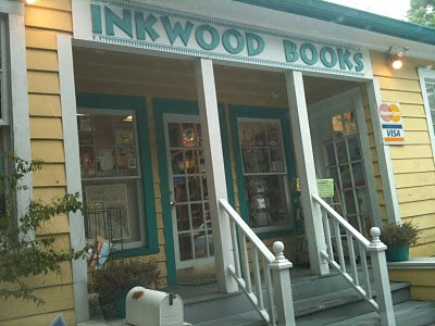 A picture of the front of the Inkwood Books store in Tampa, which is an old-timey Florida home with a front porch