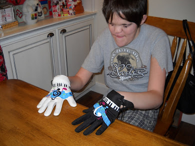 Cody Learning to Play His Electronic Piano Gloves