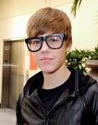 Awful nerdy glasses. Some can pull it out, on this one Justin doesn't. (justin bieber with ugly nerd glasses)