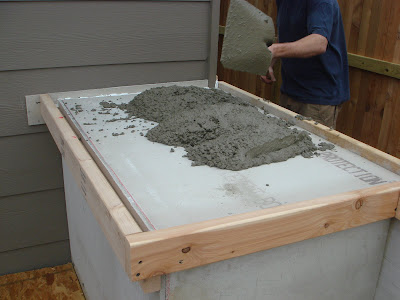 Outdoor Concrete Countertops, adding concrete into the forms