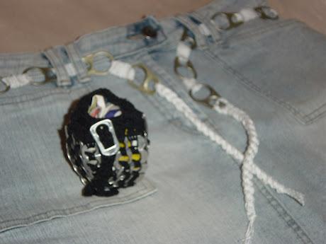 Bolsinhas e cintos com anilhas