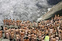 People posing naked for a photo on a glacier.