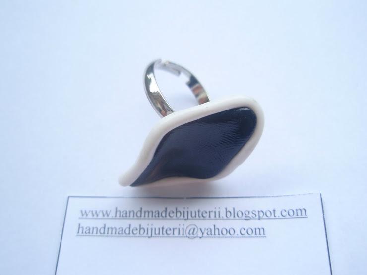Inel negru cu margine alba. Cod 063. Pret 8 ron