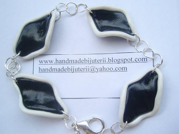 Bratara - negru cu margine alba. Cod 062. Pret 15 ron