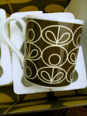Brown Orla Kiely mug by post