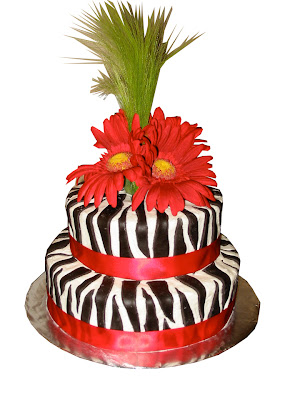 Zebra Print cake with Gerber Daisies on top. customize your color.