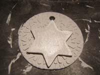 16 circulo con estrella arcilla   Colgante circular con estrella