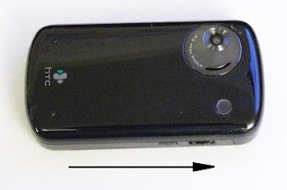 To open HTC3600 phone, slide the cover in this direction
