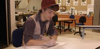 Zeke Tracy works on his drawing project