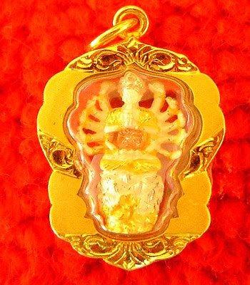 Kwan Yin amulet in gold case