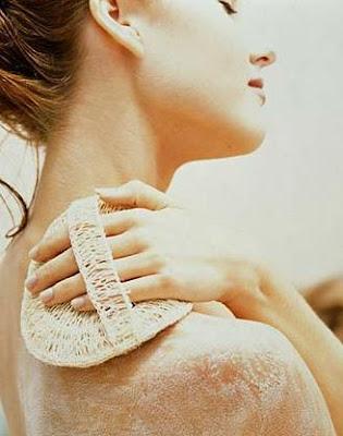 Woman applying Exfoliate