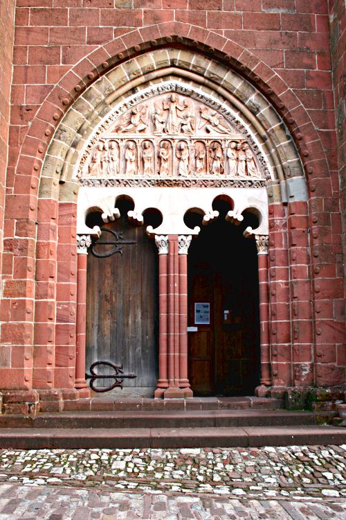Doorway in a red stone church in Collonges la Rouge near Brive