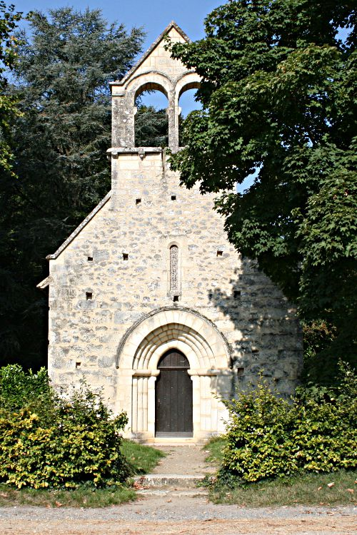 small stone chapel in the trees