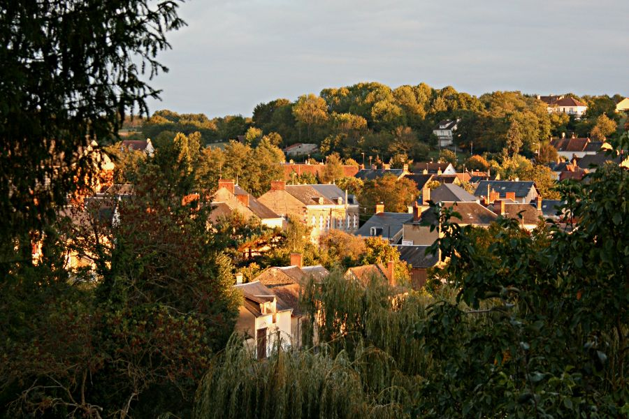 evening sun catching houses across the valley
