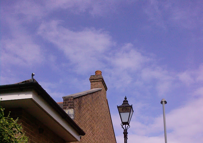 TWO LAMPOSTS, A CHIMNEY AND A ROOF ON BOOT HILL