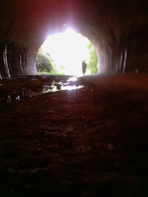 CYCLIST AT THE END OF A TUNNEL