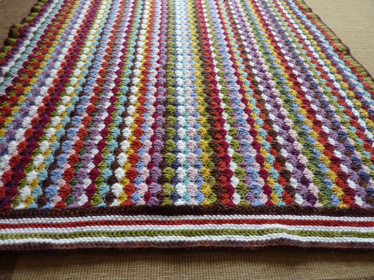 "crochet and blanket This beautiful blanket features a dragonfly motif in colorful rainbow rows and a ""fluffy"" white border it makes a lovely gift for a new baby or a gorgeous."