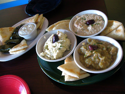 Hummus and baba ghanoush, and terokafteri and dolmades with tzatziki at the Athina Grill
