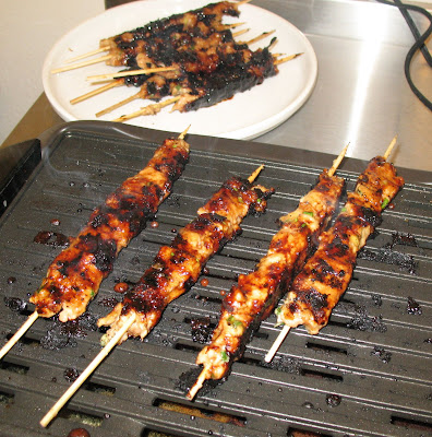 cooking tsukune on an indoor grill