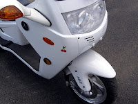 Three-wheeled scooter - Subcompact Culture